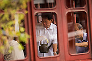 An attendant serves tea in the Huxinting Teahouse in Yu Yuan Gardens Shanghai, China