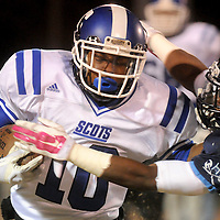 Scotland Quadrin Williams rushes against Hoggard's Josh Jones Friday November 28, 2014 at Hoggard High School in Wilmington, N.C. (Jason A. Frizzelle)