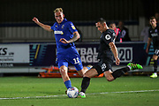 AFC Wimbledon midfielder Mitchell (Mitch) Pinnock (11) battles for possession with Brighton and Hove Albion midfielder Andrew Crofts (48) during the EFL Trophy (Leasing.com) match between AFC Wimbledon and U23 Brighton and Hove Albion at the Cherry Red Records Stadium, Kingston, England on 3 September 2019.