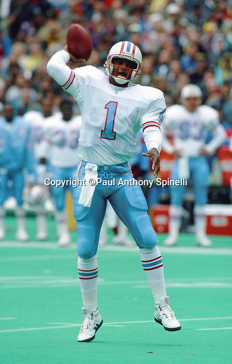 Houston Oilers quarterback Warren Moon (1) throws a pass during the NFL football game against the Pittsburgh Steelers on Nov. 1, 1992 in Pittsburgh. The Steelers won the game 21-20. (©Paul Anthony Spinelli)