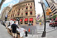 NYC Street Vendors on Fifth Avenue, selling jewelry and shawls across street from each other, with Cartier store in background, corner of 42nd Street (Place de Cartier, June 27, 2011, in Manhattan, NYC, NY, USA