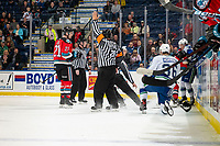 KELOWNA, BC - OCTOBER 16:  Referee Sean Raphael calls a penalty as Mark Liwiski #9 of the Kelowna Rockets drops the gloves against the Swift Current Broncos at Prospera Place on October 16, 2019 in Kelowna, Canada. (Photo by Marissa Baecker/Shoot the Breeze)
