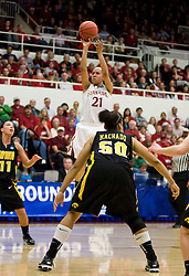 March 22, 2010; Stanford, CA, USA;  Stanford Cardinal guard Rosalyn Gold-Onwude (21) shoots a three point basket over Iowa Hawkeyes forward Gabby Machado (50) during the first half in the second round of the 2010 NCAA womens basketball tournament at Maples Pavilion.  Stanford defeated Iowa 96-67.