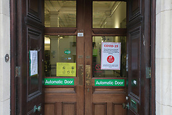 Covid 19 - Sign at a Bank. Open but practising 2- metre distancing during Coronavirus lock down in Swanage Dorset. UK April 2020