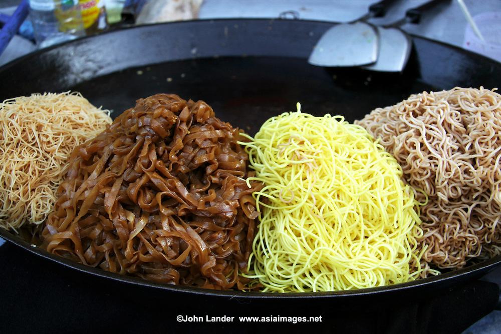 Bangkok Street Food Vendors, with a wok-full of Pad Thai