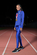 Dalilah Muhammad (USA) poses with 2019 IAAF World Athletics Championships gold medals in the women's 400m hurdles and 4 x 400m relay, Monday, Dec. 16, 2019, in Lake Balboa, Calif. Muhammad, the 2016 Rio Olympics, is the world record holder in the 400m hurdles at 52.16 seconds. Muhammad is only the second female 400 meter hurdler in history, after Sally Gunnell, to have won the Olympic and World titles and broken the world record.