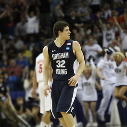 Mar 24, 2011; New Orleans, LA; Brigham Young Cougars guard Jimmer Fredette (32) reacts after hitting a three point basket against the Florida Gators during the second half of the semifinals of the southeast regional of the 2011 NCAA men's basketball tournament at New Orleans Arena.  Mandatory Credit: Derick E. Hingle