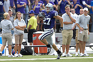 MANHATTAN, KS - OCTOBER 06:  Wide receiver Jordy Nelson #27 of the Kansas State Wildcats rushes down the sideline for a 68-yard touchdown against the Kansas Jayhawks in the first quarter, during a NCAA football game on October 6, 2007 at Bill Snyder Snyder Stadium in Manhattan, Kansas.  Kansas won 30-24.  (Photo by Peter Aiken/Getty Images)