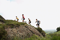 Group of people running in countryside