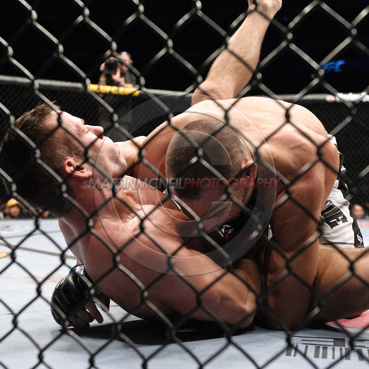 """LONDON, ENGLAND, JUNE 7, 2008: Marcus Davis (left) is taken down to the canvas by Mike Swick during """"UFC 85: Bedlam"""" inside the O2 Arena in Greenwich, London on June 7, 2008."""