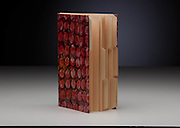 Paste paper covers attached to a signature sewn book using index cards by Jane Noble