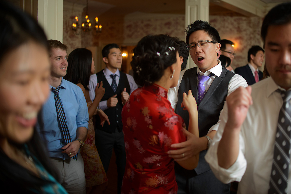 Photo by Matt Roth.Assignment ID: 30140754A..Evelyn Hsieh and Michael Wong dance during their reception at the the Mount Vernon Inn, in Mount Vernon, Virginia on Saturday, April 06, 2013. Evelyn changed from her white wedding dress to a traditional red Chinese wedding dress.