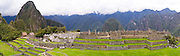 Panoramic view of the Main Plaza at the Incan ruins of Machu Picchu with Huayna Picchu on the left, near Aguas Calientes, Peru.