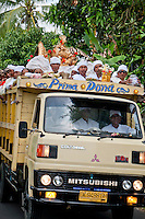 Truckload of Balinese Hindus heading to the sea in a religious procession