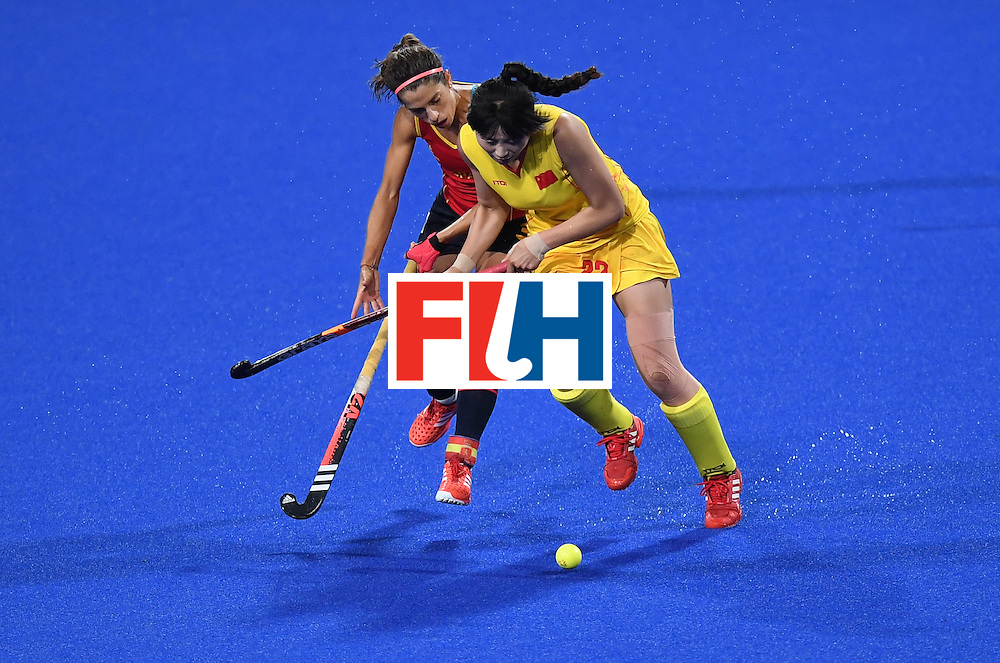 China's Song Qingling (R) vies with Spain's Rocio Ybarra during the women's field hockey Spain vs China match of the Rio 2016 Olympics Games at the Olympic Hockey Centre in Rio de Janeiro on August, 8 2016. / AFP / MANAN VATSYAYANA        (Photo credit should read MANAN VATSYAYANA/AFP/Getty Images)