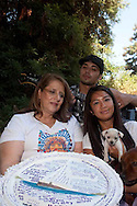 """Rachel Cobarrubias joined a support group Mothers of an Angel after her son Eric was killed by a reckless driver. In the photos taken at Woodward Park, Rachel and Eric's fiance Airlia are wearing the same shirts they wore to the criminal court proceedings. The shirts represent Eric's beliefs of """"Peace, Rain & Prosperity."""""""