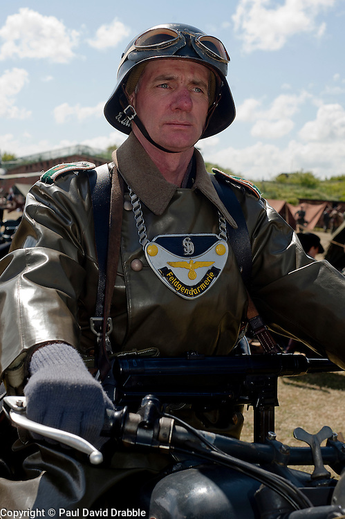 Known by German soldiers of the period as kettenhund or Chain Dogs a reenactor portrays a second world war Field Policeman at  Fort Paul<br />