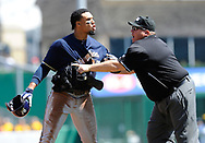 PITTSBURGH, PA - APRIL 20:  Carlos Gomez #27 of the Milwaukee Brewers is restrained by Homeplate Umpire Fieldin  Culbreth during the third inning against the Pittsburgh Pirates on April 20, 2014 at PNC Park in Pittsburgh, Pennsylvania.  (Photo by Joe Sargent/Getty Images) *** Local Caption ***Carlos Gomez