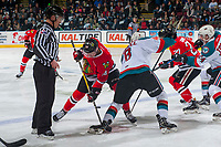 KELOWNA, CANADA - APRIL 7: Jake Gricius #14 of the Portland Winterhawks faces off against Jack Cowell #8 of the Kelowna Rockets on April 7, 2017 at Prospera Place in Kelowna, British Columbia, Canada.  (Photo by Marissa Baecker/Shoot the Breeze)  *** Local Caption ***