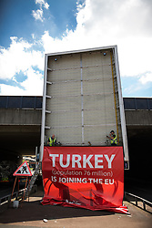 © Licensed to London News Pictures . 23/06/2016 . Salford , UK . A poster , in favour of a Brexit and paid for by Vote Leave , which states that Turkey is joining the EU , is removed by workmen on the day of polling in the EU referendum in the UK . The poster had been displayed by an underpass on Irwell Street , on the border of Manchester City Centre . Photo credit: Joel Goodman/LNP