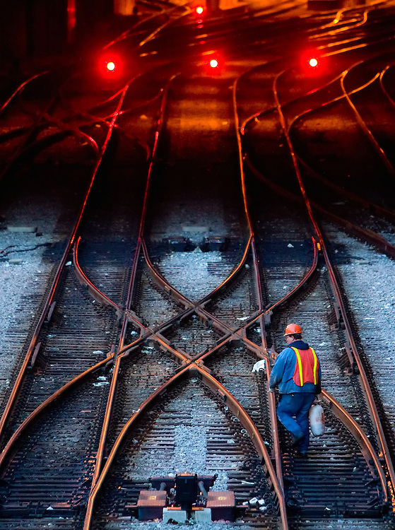 An Amtrak maintainer sprays the crossovers at the north end of Union Station in Chicago, IL with a special lubricant to keep them working smoothly. Any small problem with these switches could lead to delays for the hundreds of daily commuter trains into and out of this busy station.