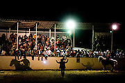 A crowd gathers for bull riding, or Jaripeo, in Von Ormy, Texas.