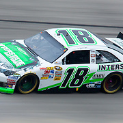 Kyle Busch #18 rounds turn three during Sprint Cup Series Sunday, Oct. 02, 2011 at Dover International Speedway in Dover Delaware.