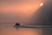 Sunrise at Port Mann Bridge and Fraser River in Fog, Coquitlam, British Columbia, Canada