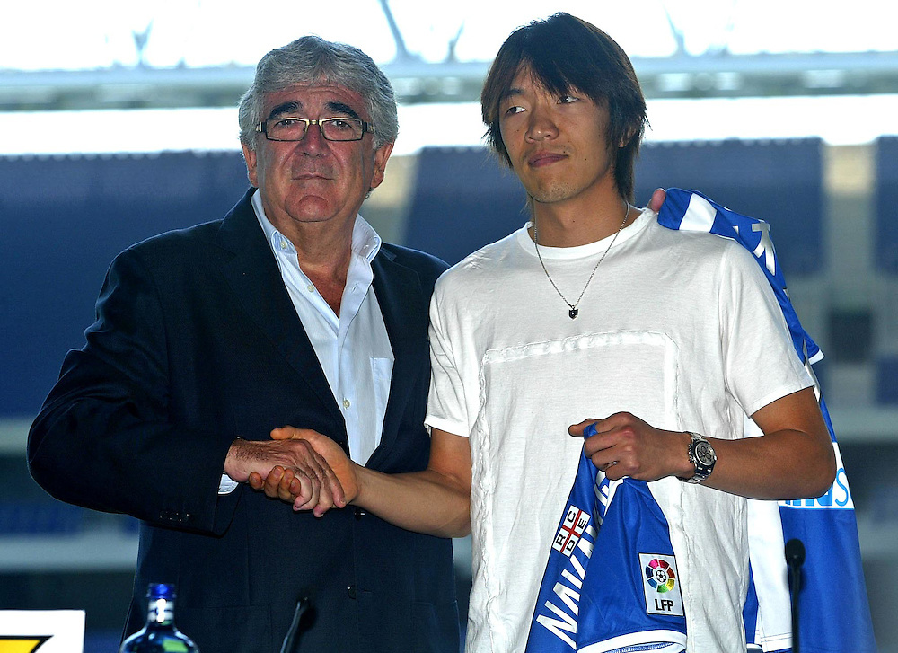 "July 13th. 2009. Official presentation of Shunsuke Nakamura as a  new player of the R.C.D. Espanyol of Barcelona. More than seven thousand supporters and numerous mass media have been present  in the presentation of the new player of the team of first Spanish division league  ""La Liga"".  In the image  the Japanesse player with the president of R.C. D. Espanyol, Mr. Daniel Sanchez Llibre, on his right side."