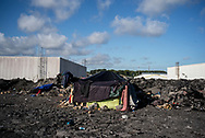 A shelter where many migrant live on the top a hill composed of industrial waste in the Calasi industrial area where hundres migrants and refugee are living waiting to cross the channel to UK. Calais. France. FEDERICO SCOPPA