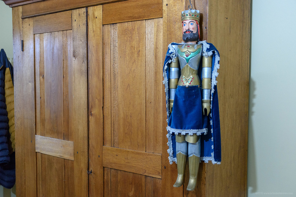 A Belgian puppet hangs in the side entrance foyer at the home of Kristen and David Embry in Pendleton, Ky. Feb. 22, 2018
