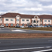 December 27, 2012 - Wall Township, NJ : Education & Health Centers of America, a nonprofit group which runs halfway houses, has office space at 3350 State Route 138 -- a busy stretch of divided highway near the Garden State Parkway in Wall Township, NJ. Pictured here is building 2, which houses suite 222, the address for Education & Health Centers of America, seen from across Route 138. CREDIT: Karsten Moran for The New York Times