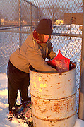 Homeless woman age 50 digging in the trash.  St Paul Minnesota USA
