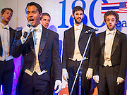 "19 JULY 2013 - BANGKOK, THAILAND:  MICHAEL PROTACIO, a  Yale senior English major, fronts the Whiffenpoofs during their show in Bangkok Friday. The Yale Whiffenpoofs, one of the best-known collegiate a cappella groups in the world performed in CentralWorld in Bangkok Friday. Founded in 1909, the ""Whiffs"" began as a senior quartet that met for weekly concerts at Mory's Temple Bar, the famous Yale tavern. The Bangkok stop was a part of their 2013 world tour and was sponsored by the US Embassy. They sang at the opening of a photo exhibit that marked 180 years of friendly diplomatic relations between Thailand and the United States.    PHOTO BY JACK KURTZ"