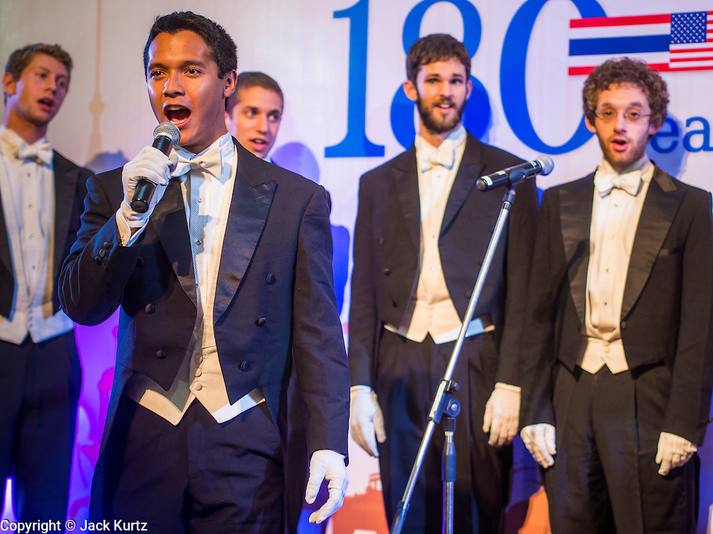 """19 JULY 2013 - BANGKOK, THAILAND:  MICHAEL PROTACIO, a  Yale senior English major, fronts the Whiffenpoofs during their show in Bangkok Friday. The Yale Whiffenpoofs, one of the best-known collegiate a cappella groups in the world performed in CentralWorld in Bangkok Friday. Founded in 1909, the """"Whiffs"""" began as a senior quartet that met for weekly concerts at Mory's Temple Bar, the famous Yale tavern. The Bangkok stop was a part of their 2013 world tour and was sponsored by the US Embassy. They sang at the opening of a photo exhibit that marked 180 years of friendly diplomatic relations between Thailand and the United States.    PHOTO BY JACK KURTZ"""