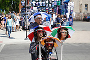 CHICAGO, IL - MAY 18: A rather bizarre vendor peddles umbrella hats prior to the game between the Chicago Cubs and the New York Mets on May 18, 2013 at Wrigley Field in Chicago, Illinois. The Cubs won 8-2. (Photo by Joe Robbins)
