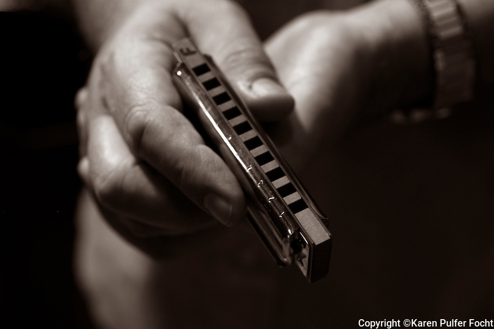 Harmonica in the hands of professional blues harmonica player R.J. Mischo