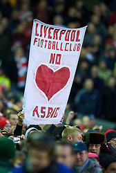LIVERPOOL, ENGLAND - Sunday, December 13, 2009: A Liverpool supporter with a banner reading 'Liverpool Football Club No Heart As Big' during the Premiership match at Anfield. (Photo by: David Rawcliffe/Propaganda)
