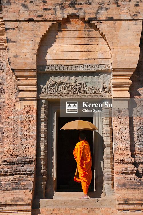 Monk in Prasat Kravan with brick structure, Angkor Wat, UNESCO World Heritage site.