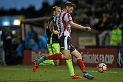 Lincoln City Defender Luke Waterfall (5) blocks the run of Brighton & Hove Albion centre forward Glenn Murray (17) during the The FA Cup fourth round match between Lincoln City and Brighton and Hove Albion at Sincil Bank, Lincoln, United Kingdom on 28 January 2017.