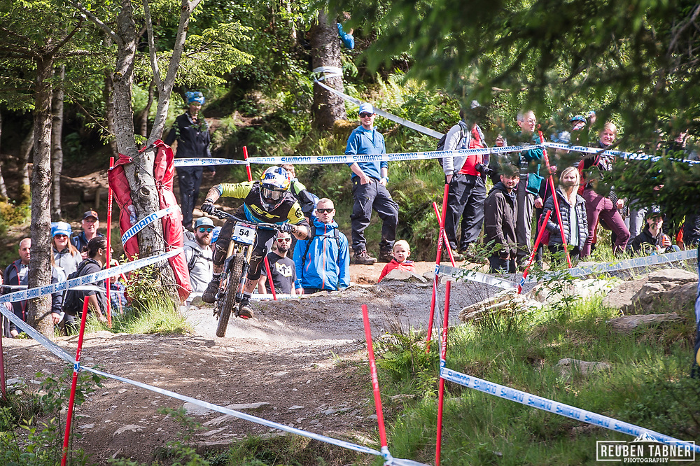 Brook MacDonald steps on the gas during his race run at the UCI Mountain Bike World Cup in Fort William.