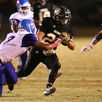 Lauren Wood | Buy at photos.djournal.com<br /> Pontotoc's Gabe Harmon runs out of reach from Noxubee County's Rashad Eades during Friday night's playoff game at Pontotoc.