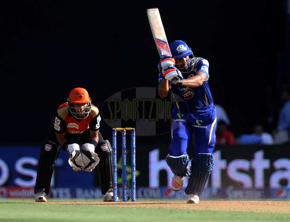 Mumbai Indians captain Rohit Sharma plays a shot during match 23 of the Pepsi IPL 2015 (Indian Premier League) between The Mumbai Indians and The Sunrisers Hyderabad held at the Wankhede Stadium in Mumbai India on the 25th April 2015.<br /> <br /> Photo by:  Vipin Pawar / SPORTZPICS / IPL