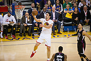 Golden State Warriors center Zaza Pachulia (27) floats a ball at the basket against the LA Clippers at Oracle Arena in Oakland, Calif., on January 28, 2017. (Stan Olszewski/Special to S.F. Examiner)
