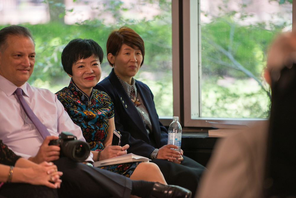 Ying Zhang (Center) and Yang Yang (Right) listen to Dr. Dr. Hwa- Wei Lee speak about his biography at Alden Library. Yang is the author of Dr. Lee's Biography, The Sage in the Cathedral of Books. Zhang translated the book into from Chinese to English. Photo by Ben Siegel