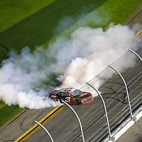 Austin Dillon, driver of the #3 Dow Chevrolet does a burnout after winning the 60th Annual NASCAR Daytona 500 auto race at Daytona International Speedway on Sunday, February 18, 2018 in Daytona Beach, Florida.  (Alex Menendez via AP)