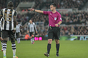 Andrew Madley (Referee) points to the spot to award Newcastle a penalty during the EFL Cup 4th round match between Newcastle United and Preston North End at St. James's Park, Newcastle, England on 25 October 2016. Photo by Mark P Doherty.