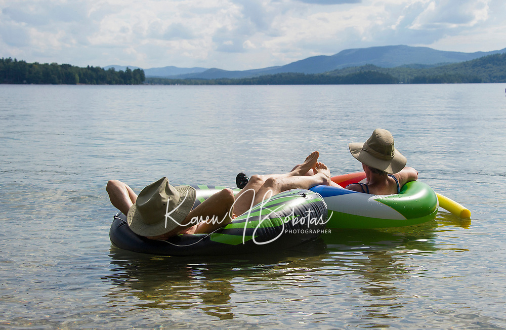 Ready for the hazy, lazy days of summer while floating in Lake Newfound.    Karen Bobotas for the Laconia Daily Sun