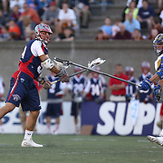Paul Rabil #99 of the Boston Cannons watches his shot during the game at Harvard Stadium on May 17, 2014 in Boston, Massachuttes. (Photo by Elan Kawesch)