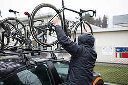 A Wiggle Hi5 Cycling Team mechanic takes a bike off the team care before the Trofeo Alfredo Binda - a 131,1 km road race, between Taino and Cittiglio on March 18, 2018, in Varese, Italy. (Photo by Balint Hamvas/Velofocus.com)